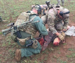 SWAT Tactical Medic treat a victim during the Basic SWAT Tactical Medic Course