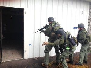 SWAT Officers deploy a training diversionary device.